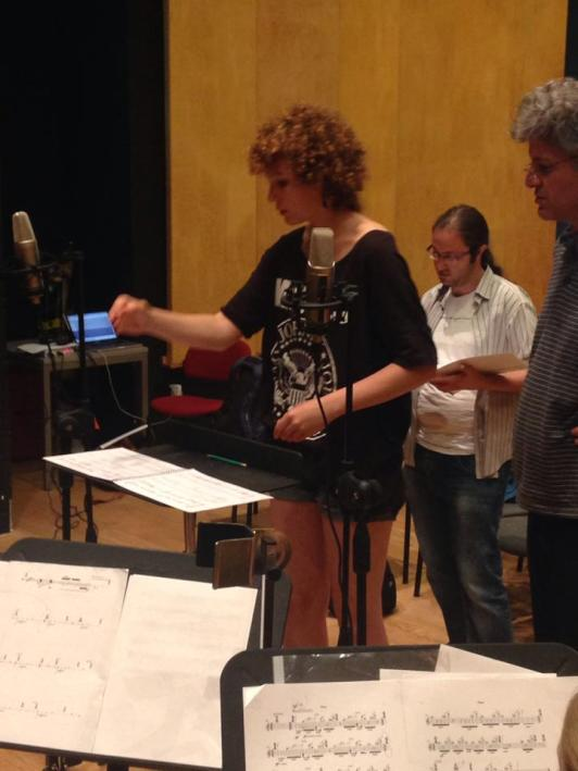 "Helena Cánovas Parés rehearsing my piece ""Don't condescend (Don't even disagree)"" (2014) with the Meitar Ensemble and Guy Feder. Me, looking at the score, in the back."