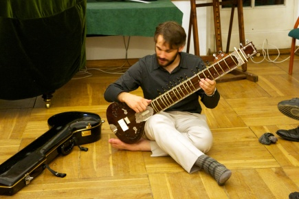 Tomek Regulski offering his Sitar to us after last day's farewell party. Thank you!